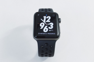 Apple Watch Series 5 with black band, nike screen, and a white background.