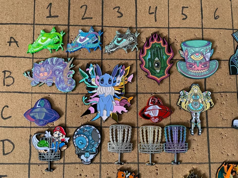 corkboard enamel pin display with grids