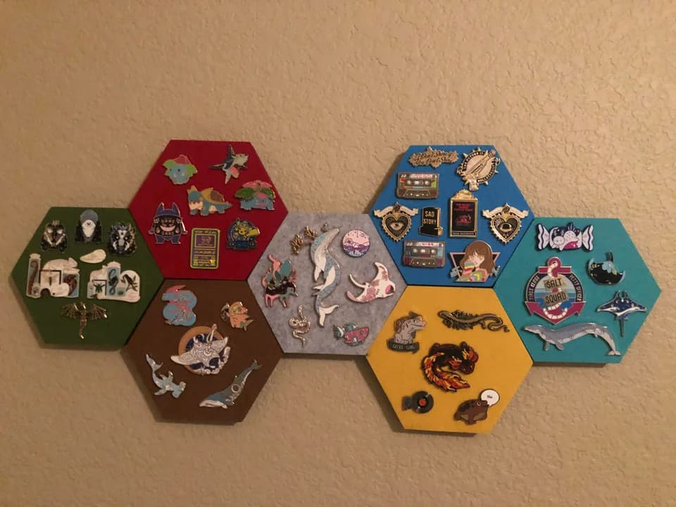 Hexagon-shaped enamel pin displays