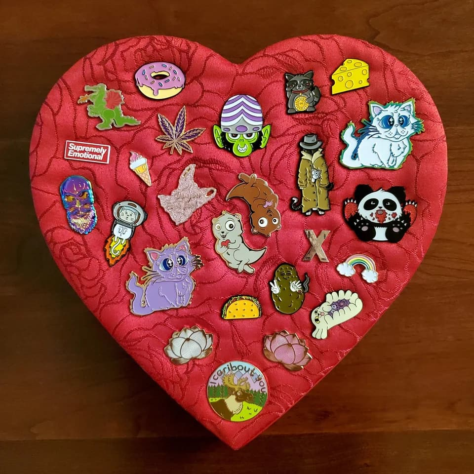 heart-shaped enamel pin display