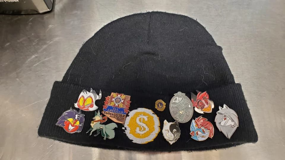 stocking hat with enamel pins attached