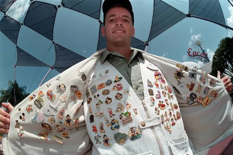Vest and jacket filled with Disney enamel pins