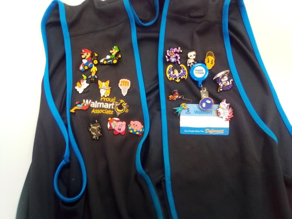 Walmart vest with enamel pins attached