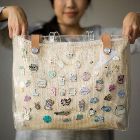 Bag with several enamel pins attached