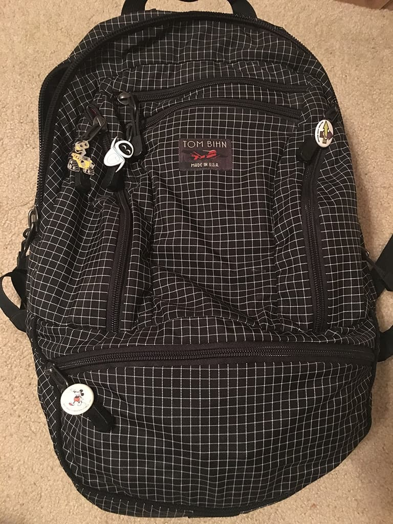 Backpack with enamel pins attached to the zippers