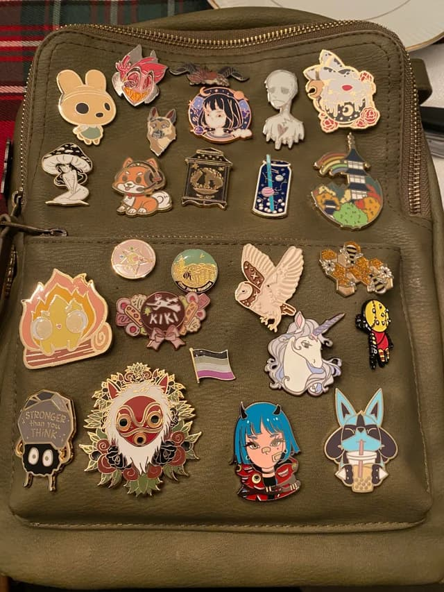 Canvas bag with several enamel pins attached