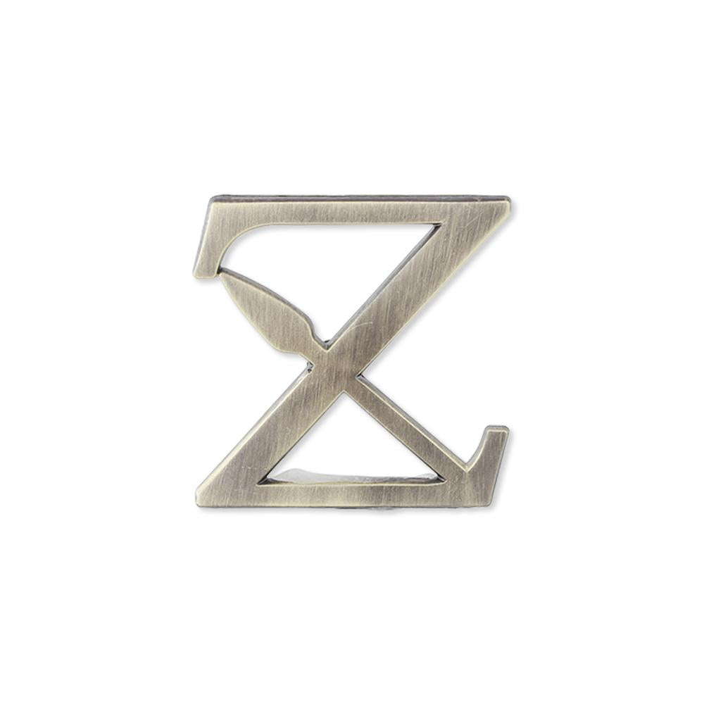 Custom antique distressed vintage lapel pin bespoke lettering with badge style clasp and cutout details in the shape of the letter Z