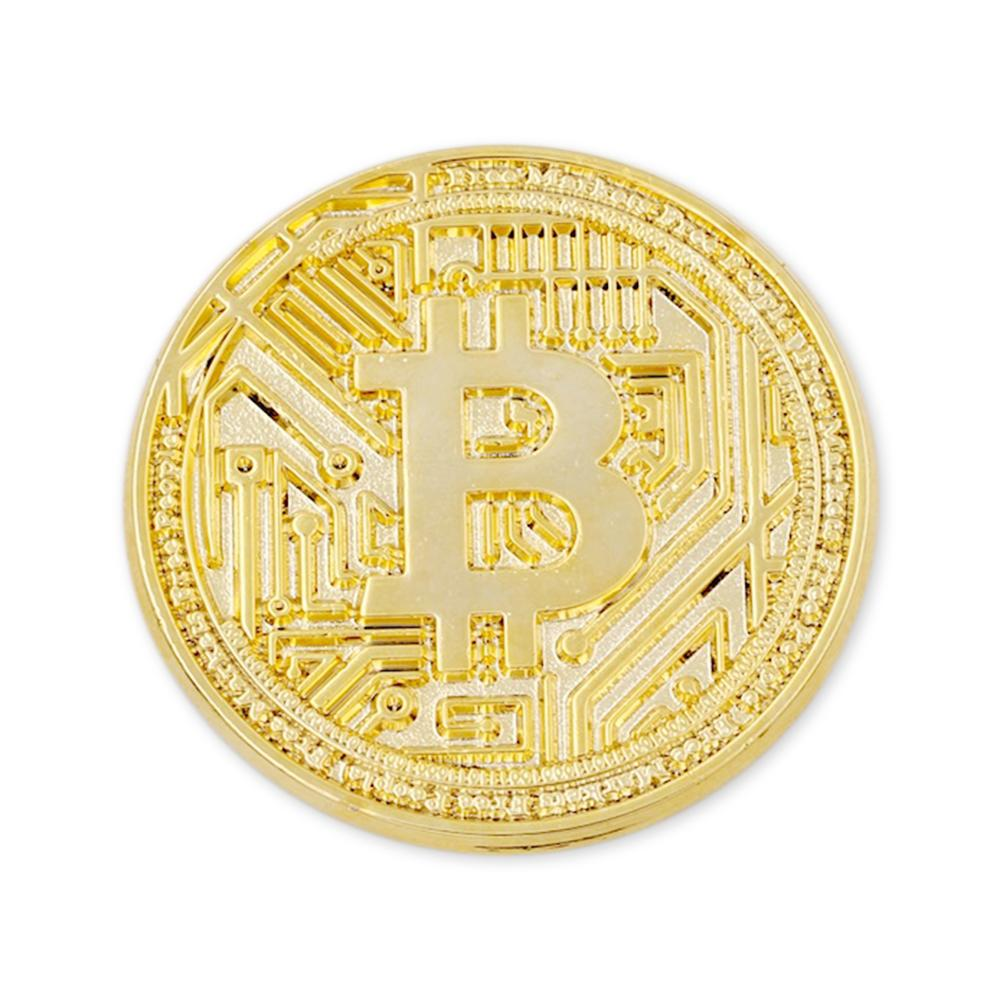 gold metal coin with bitcoin logo