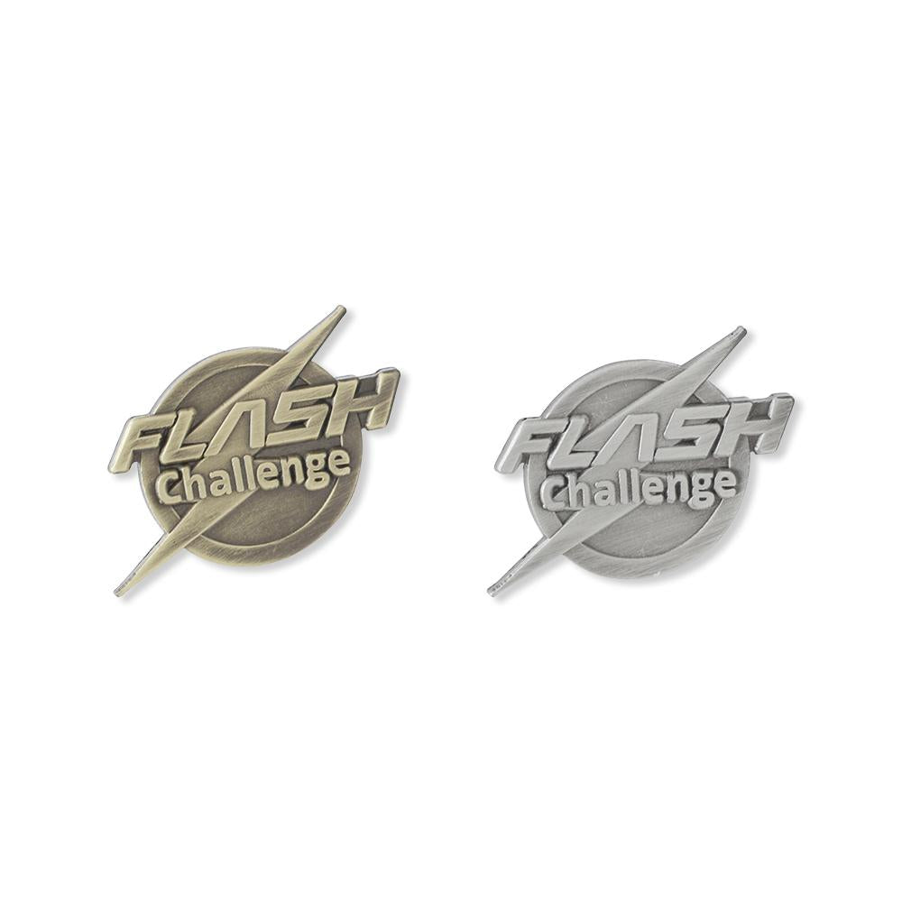Custom diecut and diestruck pins showing the difference between antique gold and antique silver plating