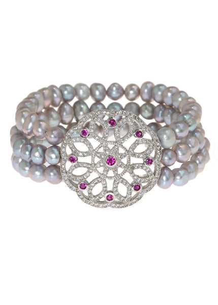 Three rows of gray pearl stretch bracelet accented with art deco medallion in hand set micro pave high quality CZ, White gold finish