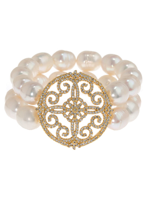 Two rows of White pearl stretch bracelet accented with art deco medallion in hand set micro pave high quality CZ, Gold finish