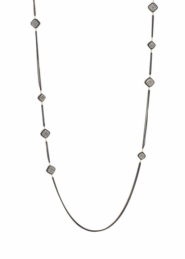 Black gold chain framed long strand necklace with hand set Hematite, 16 square motif. Black gold finish.