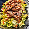 Grilled Miyazakigyu Wagyu Strip Steak Over Jalapeno Slaw
