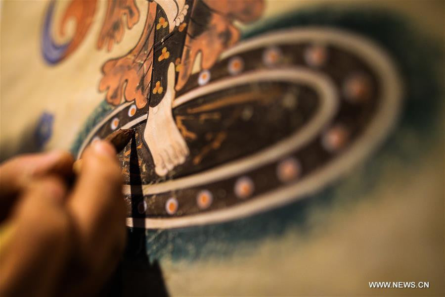 Rock-color paintings created in NW China's Dunhuang