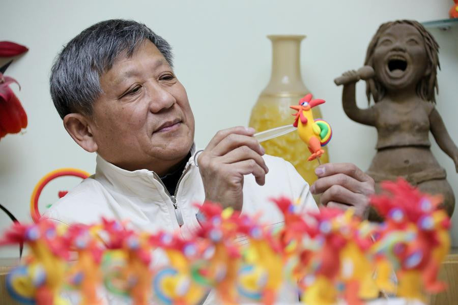Rooster-shaped dough modellings made to greet Chinese lunar new year