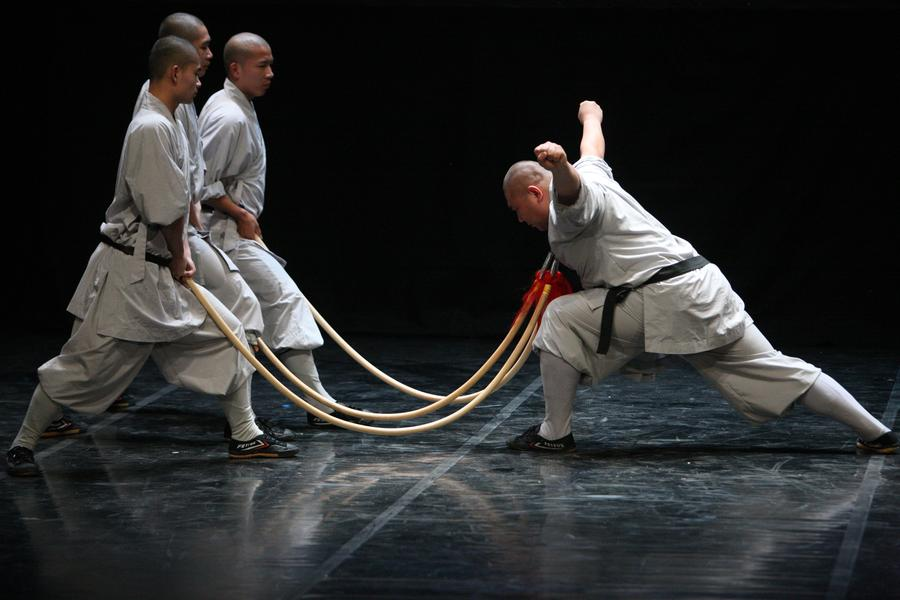 Chinese monks perform Chinese Shaolin martial arts at a theater in Nicosia, capital of Cyprus, on Jan 10, 2017. [Photo/Xinhua]