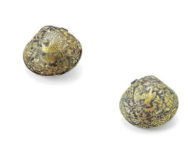 Two gilded compacts with patterns of phoenixes from the Tang Dynasty (618-907).  [Photo/Artron.net]