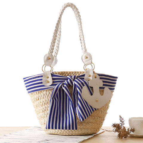 Multicolored striped bow tie beach style woven bag