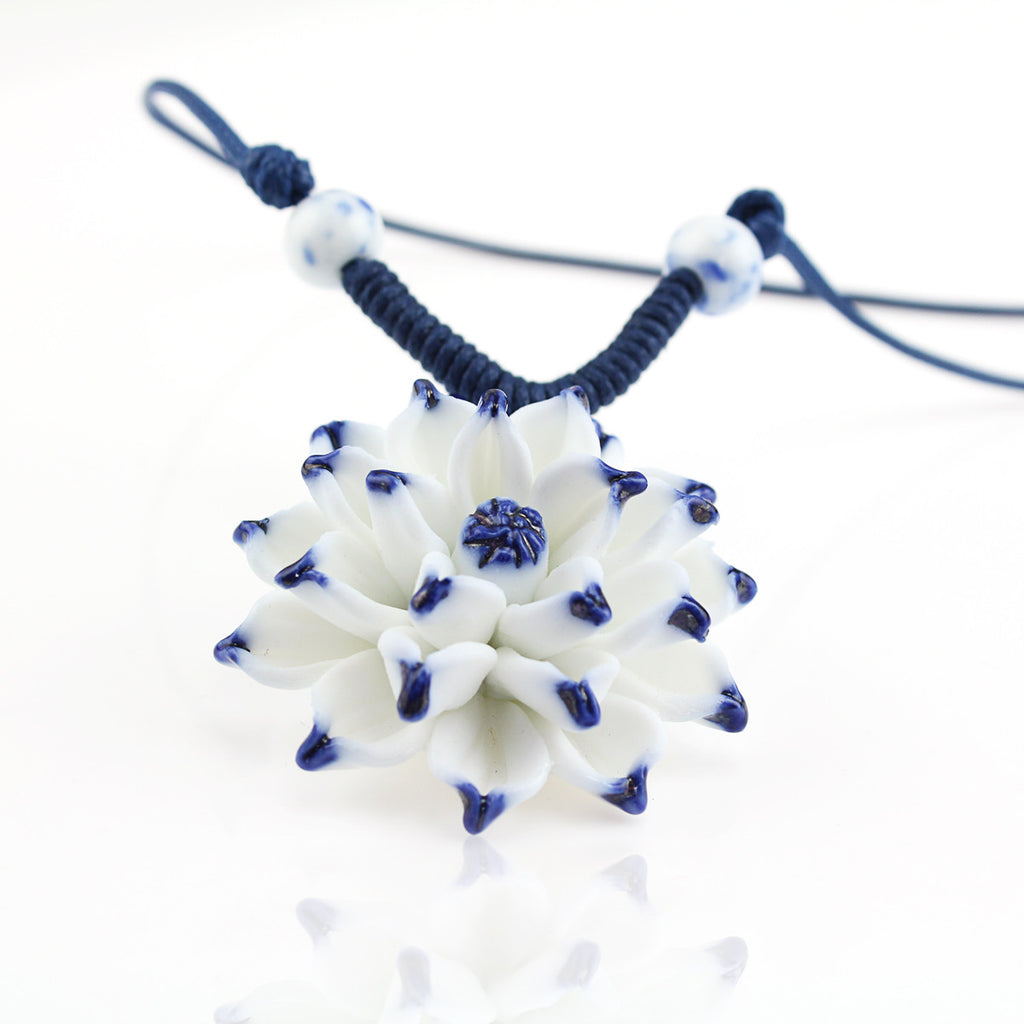 Handmade ceramic necklace with lotus pendant