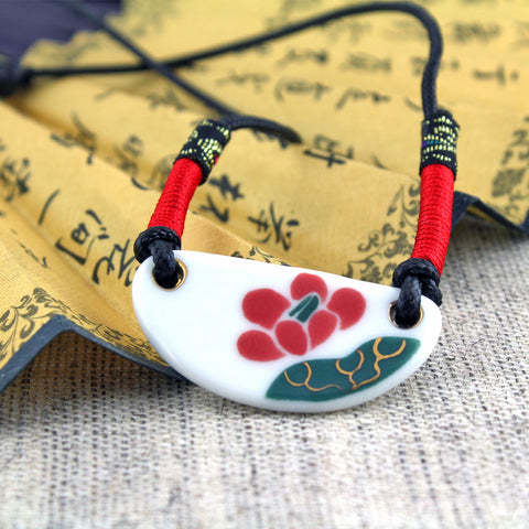 Oriental style handmade crescent-shaped pink porcelain necklace