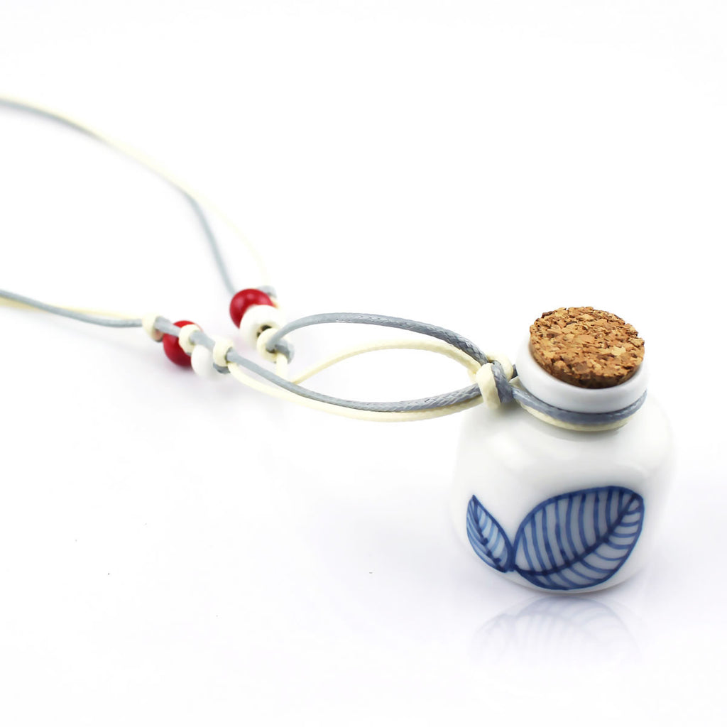 Hand-painted ceramic necklace with cyan leaf on th bottle pendant