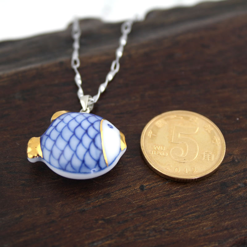 Handmade slap-up ceramic necklace with aureate fish(best wishes) pendant