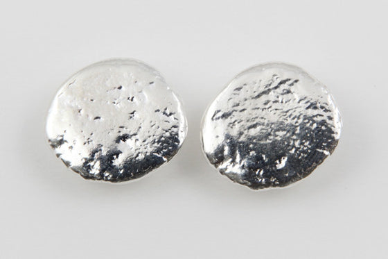Sterling silver stud earrings (approximately 2cm x 1.7cm)