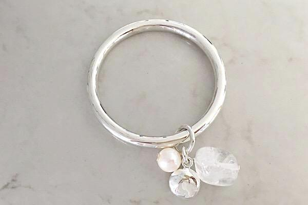 Sterling silver bangle with clear quartz, pearl and silver round pendants