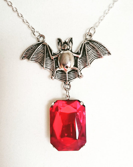 'Raised by a Bat' Necklace with Faceted Ruby Red Gem