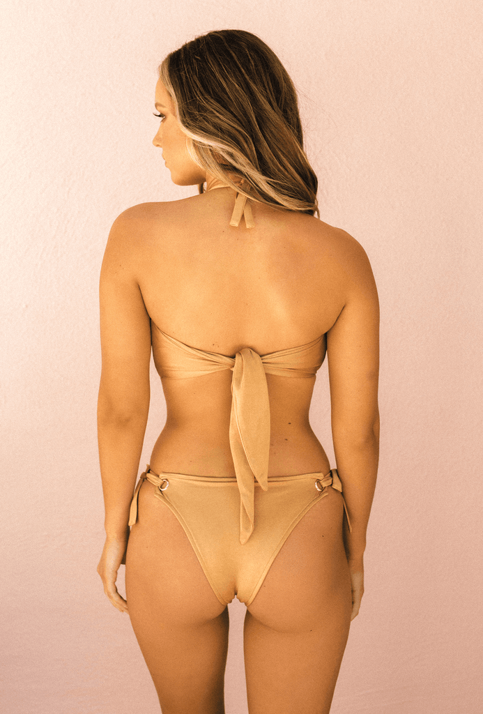 Toby Swim. Product View: BACK. Product Name : HOTEL CALIFORNIA Bandeau Bikini Top. Colour : Amber. Model wearing with West Coast Bikini Bottoms - TOBY HEART GINGER