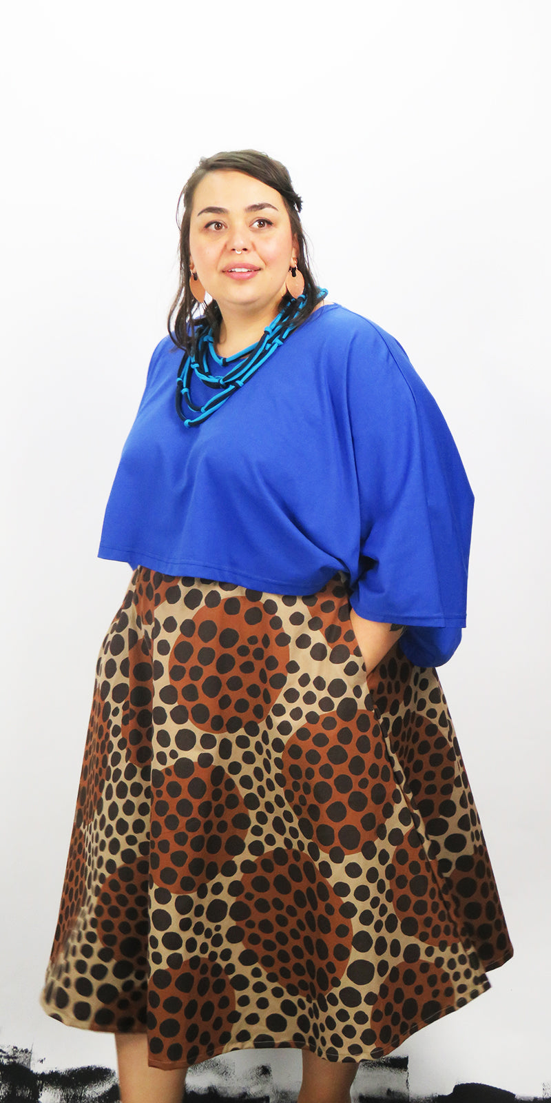 Full circle brown skirt with two side pockets and elastic on waist