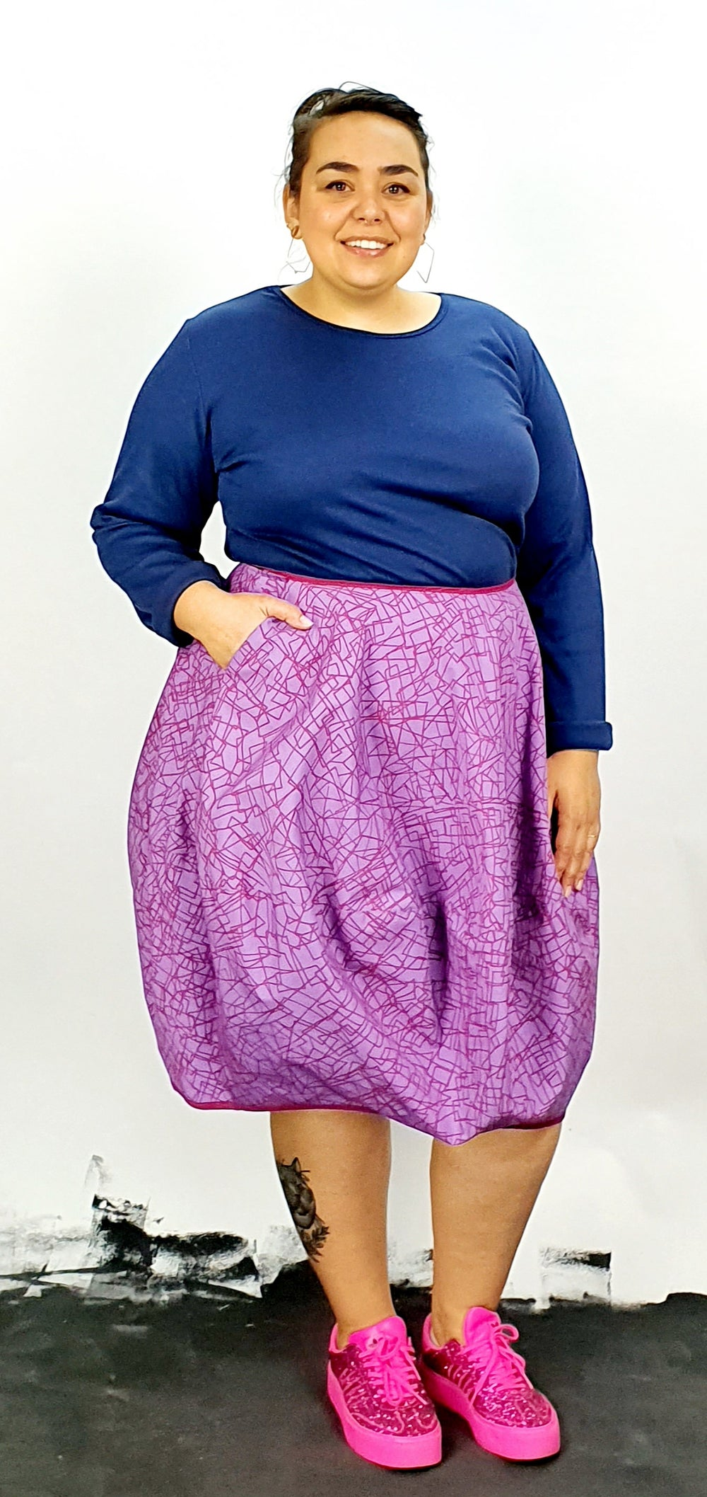 Purple bubble skirt with pink scribble print, one pocket and side zip