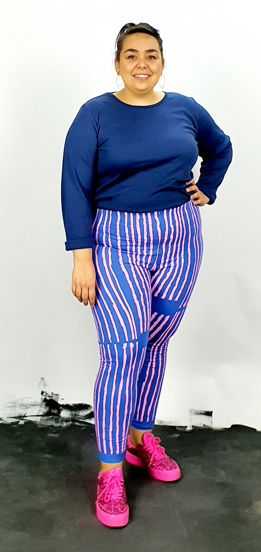 Pink vertical stripes on cotton lycra leggings