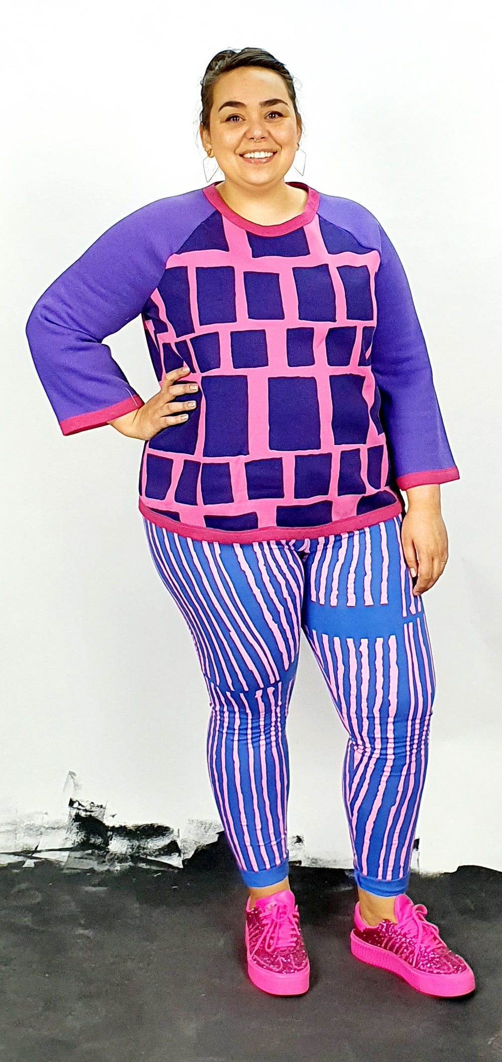 Purple and pink on raglan loose fitting fleece jumper with long sleeves