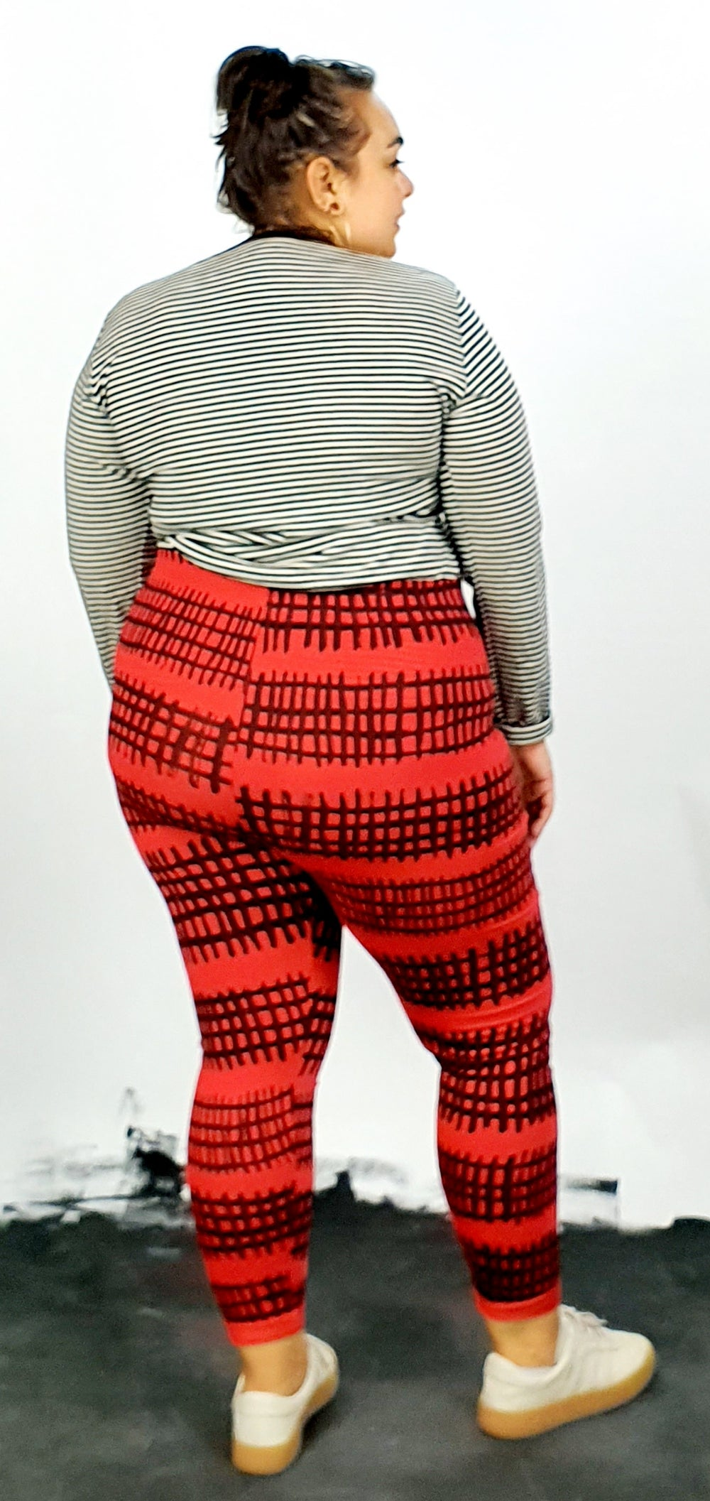 Black fence print on red cotton lycra leggings