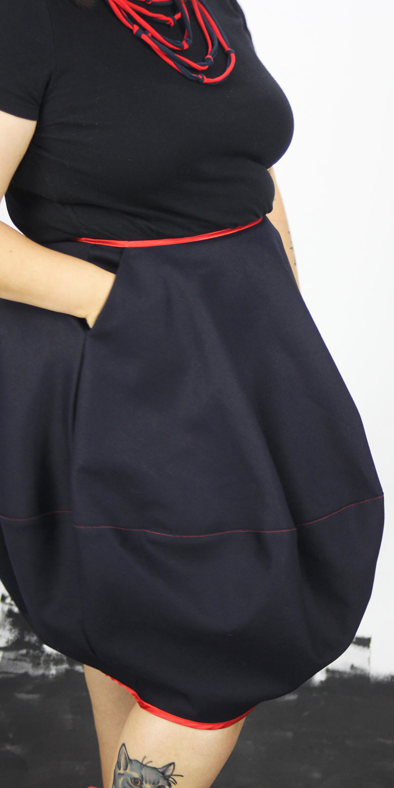 Navy denim bubble skirt with red trim, one pocket and side zip
