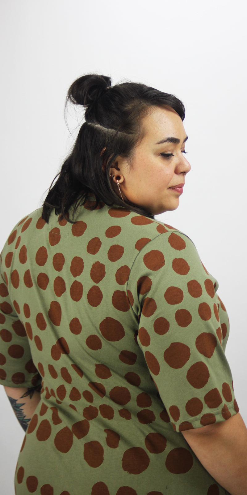 Round neck olive green pocket dress with dark brown spots and sleeves