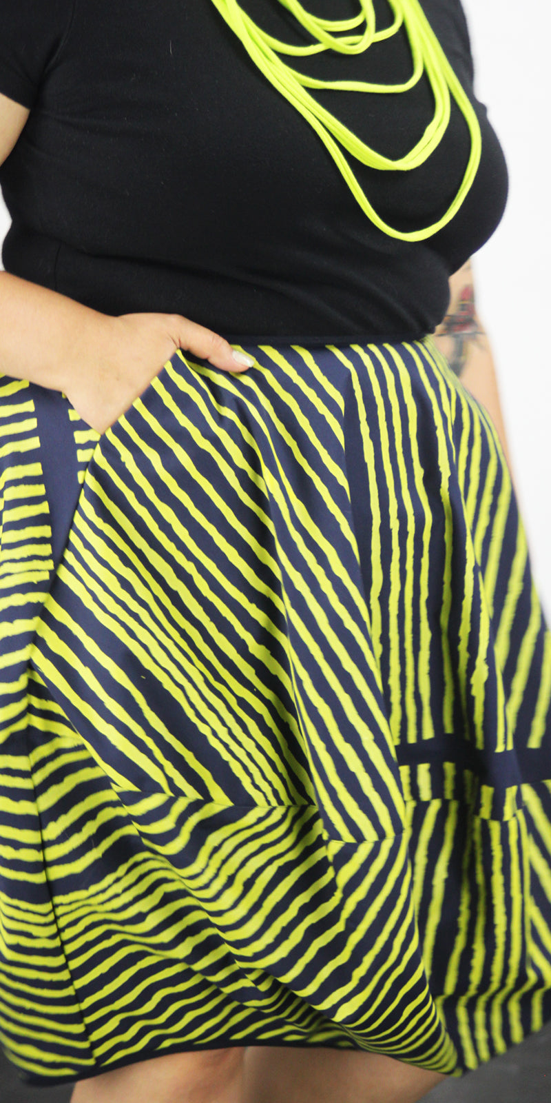 Navy bubble skirt with yellow stripes, one pocket and side zip