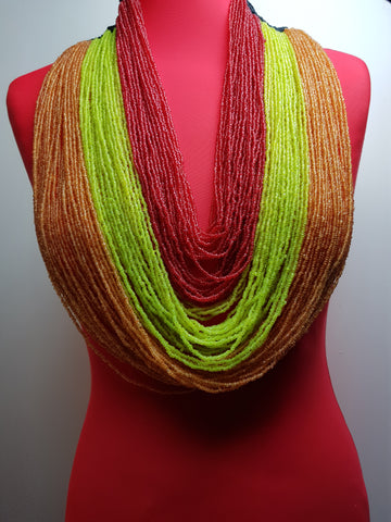Handmade multi-layered necklace made with seed beads and crocheted wool.