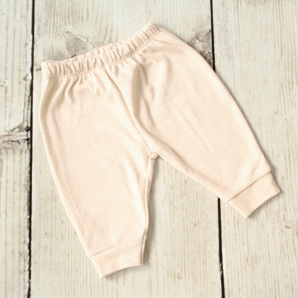 Beige cotton baby's trousers. Made in the UK