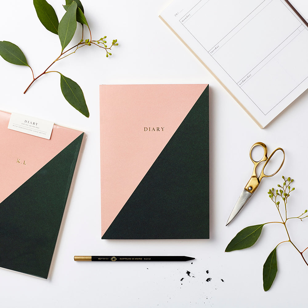 Personalised any date diary with pink and dark green design. Made in the UK. Sustainable paper.