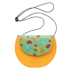 Girl's yellow cross body leather purse with popper. Made in the UK