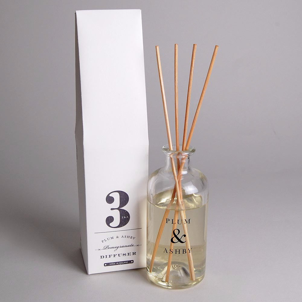 Pomegranate scented reed diffuser in vintage style glass bottle. Made in the UK
