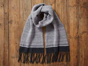 Black and charcoal fair isle 100% wool scarf with tassels. Made in the UK