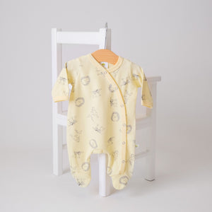 Yellow cotton baby sleep suit with woodland animal print. Made in the UK