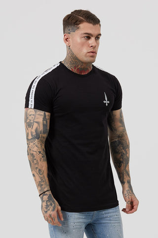 Man wearing black tape detail t-shirt