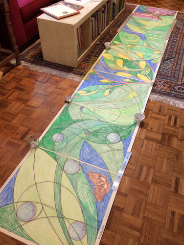 The full sketch of all seven panels laid out on the floor before the willow, paper and painting work begin.