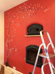 Kitchen mural project, adding flowers to the tree