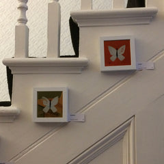 Two of my gilt butterfly paintings displayed along the hotel's staircase