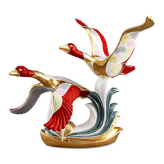 Ceramic flying geese statue
